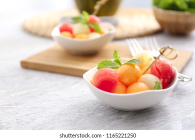 Plate with tasty melon dessert on wooden table