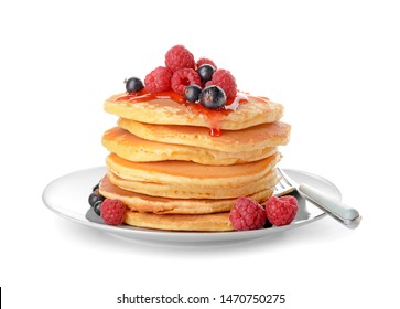 Plate with tasty pancakes and berries on white background