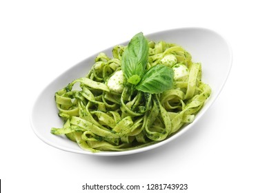 Plate with tasty pesto pasta on white background