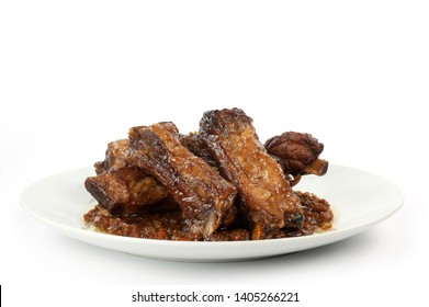 plate of tasty pork ribs cooked in the oven