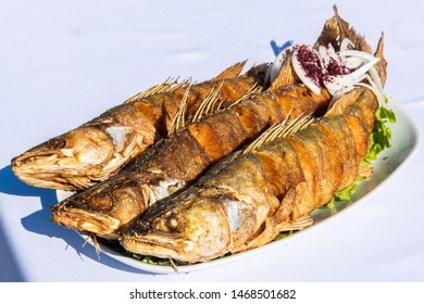 Plate with three pike-perch fish served in a fishing restaurant in Bibi-Heybat settlement of Baku, Azerbaijan.