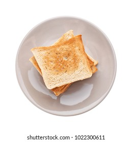 Plate with toasted bread on white background