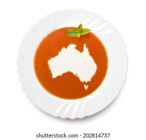 A plate tomato soup with cream in the shape of Australia.(series)