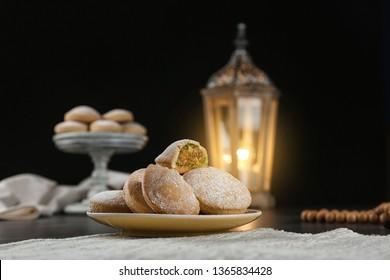 Plate of traditional cookies for Islamic holidays on table. Eid Mubarak
