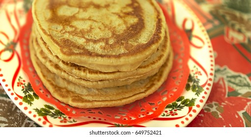 Plate of traditional fresh homemade hot pancakes for christmas breakfast