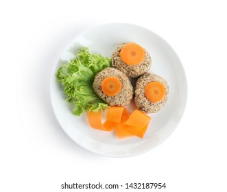Plate of traditional Passover (Pesach) gefilte fish isolated on white, top view