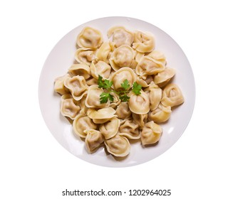 Plate of traditional russian pelmeni, ravioli or dumplings isolated on white background, top view