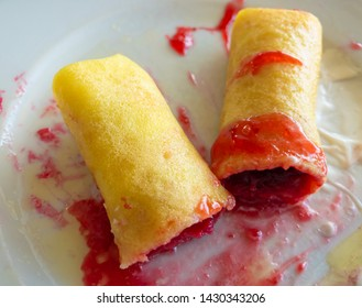 Plate with traditional Ukrainian desert - flapjacks stuffed with cherry berry, flavored with butter and sour cream