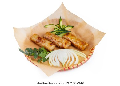 Plate of traditional vietnamese food  - cha gio spring rolls served on a wicker plate with paper isolated at white background.