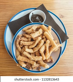Plate of typical food of Spain. Rabas , breaded squid , from Santander, Cantabria, Spain, accompanied by black squid sauce