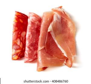 plate with various meat specialties isolated on white background, top view