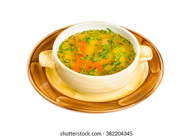Plate of vegetable soup. Isolated on white