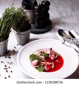 Plate of Vegetable soup at marble table