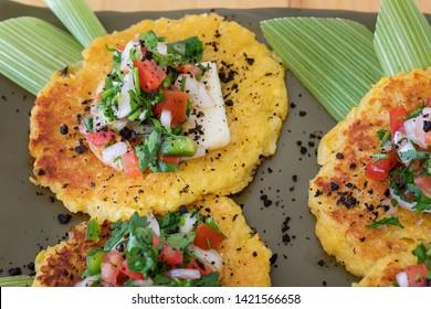 A plate of Venezuelan corn cachapitas