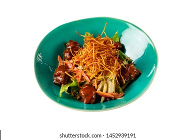 Plate of warm spicy salad with beef bbq, romano leaves and crispy pai potato isolated at white background.