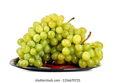 Plate of white fresh grapes isolated on white background