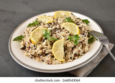 A plate of wild and brown rice with tricolor quinoa, lemon and cilantro for a healthy plant protein meal