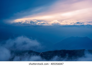 Plateau, snow capped mountains, clouds, sunset
