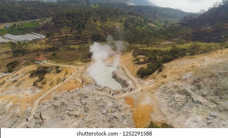 plateau with volcanic activity, mud volcano Kawah Sikidang, geothermal activity and geysers. aerial view volcanic landscape Dieng Plateau, Indonesia. Famous tourist destination of Sikidang Crater it