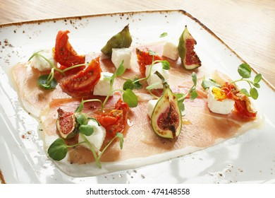 plated healthy cured ham appetizer