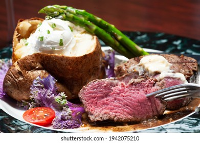 Plated steak and baked potato.