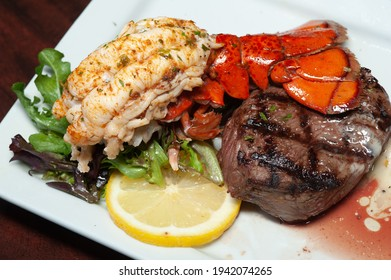 Plated steak and Lobster dinner.