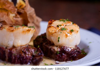 Plated Tenderloin Fillet Mignon Topped With Scallops