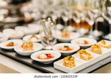 Plates with appetizers on some festive event, party or wedding reception