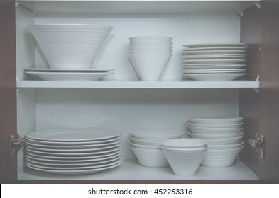 Plates and bowls in cupboard