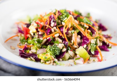 Plates with Colorful Mixed Vegetables and Greens Salad