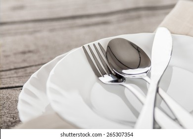 Plates and cutlery on a wooden table