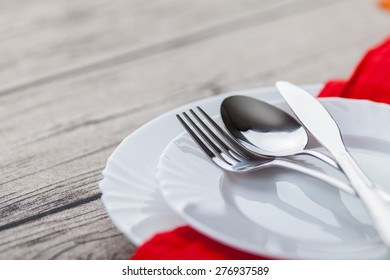 Plates and cutlery on wooden table