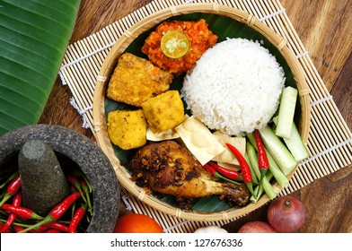 A plates of Delicious 'Ayam Penyet' with 'Sambal Belacan' and 'Tempe'- local flavor