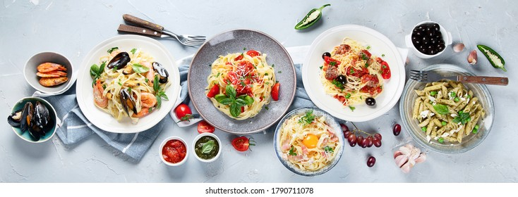 Plates of pastas with different kinds of sauces, top view.  Italian food concept. Panorama, banner