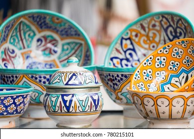 Plates, tajines and pots made of clay on the souk in Marocco.