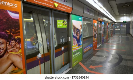 Platform Screen Doors Closing and MRT Subway Train Departing Station in Singapore - August, 2019