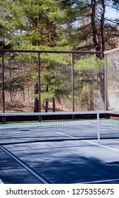 platform tennis paddle court in woods in suburban setting private club