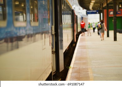 platform with train and blurred people in the background