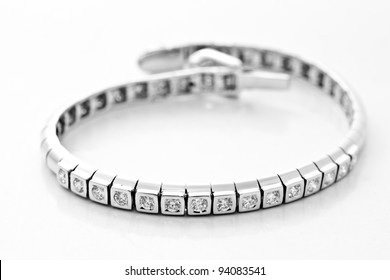 platinum lace decorated with diamonds on white background