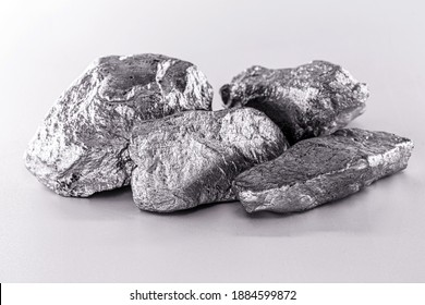 Platinum nugget on an isolated white background, is a chemical element used in the chemical industry as a catalyst for the production of nitric acid, silicone and benzene.