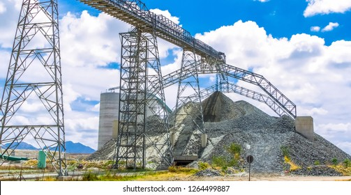 Platinum palladium Mining and Processing of ore, Piles of ore rock being moved and stored