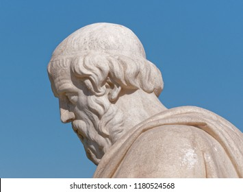 Plato the ancient greek philosopher portrait on blue sky background, detail of marble statue in Athens Greece