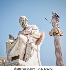 Plato the philosopher and Athena goddess of knowledge and wisdom white marble statues, Athens Greece