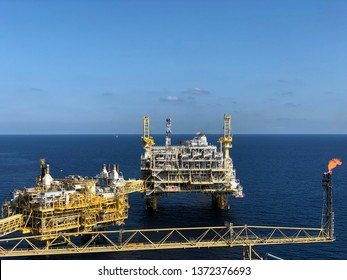 Platong Gasfield, Gulf of Thailand, Thailand : April 17, 2019 - Offshore rig platform or Offshore oil and gas Accommodation Platform or Living Quarter and Production plant with a calm sea and blue sky