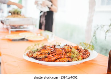 A platter of crayfish cooked in beer and dill stacked in a pile and ready to be served