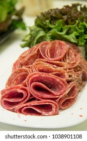 Platter of Cured Meat sausage, salame on white
