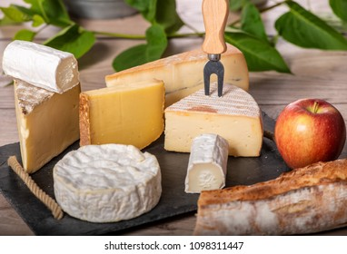 a platter of different french cheeses