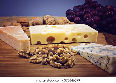 platter with different types of cheese and nuts