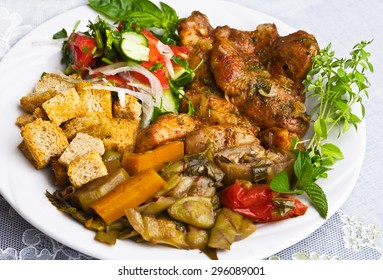 Platter of mixed meats including grilled steak, crispy  and beef  of fresh   mixed salad served with    sauce