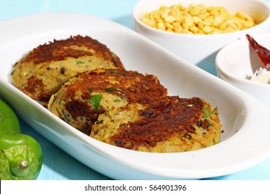 A platter of Shami kebab, made of minced chicken, goat meat, lamb or beef combined with boiled chana daal lentils and spices, selective focus.